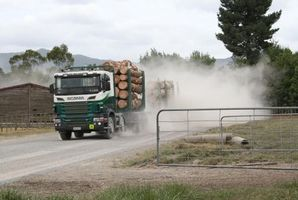 A logging truck kicks up a trail of dust on Wright Rd, Pipiwai. Photo / Graham Wright