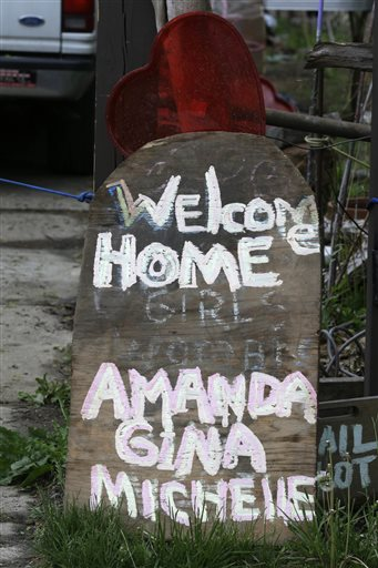A sign rests in front of a home in Cleveland where Ariel Castro allegedly held three women captive for nearly a decade. Photo / AP