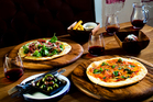 A selection of pizzas and small bites on the menu at new restaurant Blunderbass in Kingsland.Photo / Babiche Martens