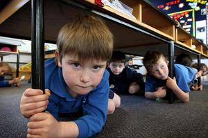School children take part in an earthquake drill. Photo / File