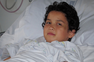 Bailey Franklin, 9, was taken to the Starship hospital with a broken pelvis last week after he was struck by a car on Atkinson Rd. Photo / Supplied