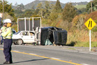 Two people died in this four-car crash north of Whangarei yesterday. One of the cars was towing another. Photo / APN
