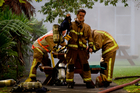 Firefighters at Auckland University's Epsom campus. Photo / Richard Robinson