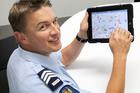 Sergeant Kelvin Giddens with an iPad. Photo / Geoff Sloan