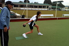 Clarry Gillies provides some bowls pointers for young learners at the New Lynn Bowling Club. Photo / Supplied
