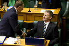 Finance Minister Bill English is congratulated Prime Minister John Key and his government colleagues after reading his fifth Budget. Photo / NZ Herald