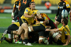 Hurricane TJ Perenara clears the ball before the Chiefs advance. Photo / Getty Images