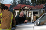 Des Evans visits the scene of yesterday's house blaze at Rangataua near Ohakune that claimed the life of his son. Photo / NZ Herald