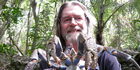 Graham Reid holds a giant land crab on Niue. The crustaceans make delicious eating. Photo / Graham Reid