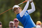Lydia Ko hits from the tee on the 15th hole during the first round of the LPGA Kraft Nabisco Championship golf tournament. Photo / AP