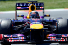 Red Bull driver Sebastian Vettel of Germany, right, steers his car during the Formula One Spanish Grand Prix. Photo / AP