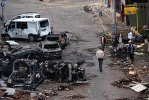 Three Syrians were among the 46 killed when the two car bombs struck the town centre on Sunday. Photo / AP