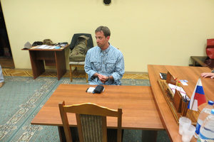 A man claimed by FSB to be Ryan Fogle, a third secretary at the U.S. Embassy in Moscow, sits in the FSB offices. Photo / AP