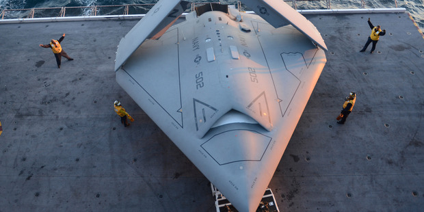 A US Navy X-47B drone is prepared for launch for the first time off the nuclear-powered aircraft carrier USS George H.W. Bush, off the coast of Virginia, yesterday. Photo / AP