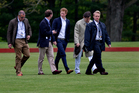 Prince Harry walks across the polo field before the Sentebale Royal Salute Polo Cup charity match in Greenwich. Photo / AP