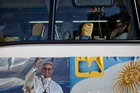 The papal bus tour of Buenos Aires rolls past 24 sites linked to the new pope but stops only twice. Picture / AP