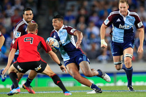 Blues player Charles Piutau was part of the winning combination that beat the Crusaders 34-15 in March. But for tomorrow's match the Blues see themselves as underdogs. Photo / Richard Robinson