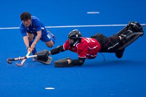 New Zealand Black Sticks goalkeeper Devon Manchester tries to stop a shot from Korea's Nam Yong Lee. Photo / Brett Phibbs