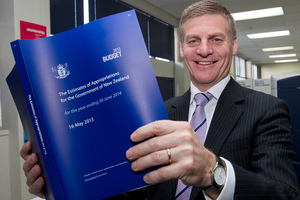 Finance Minister Bill English viewing a copy of the 2013 Budget, his fifth. Photo / Mark Mitchell