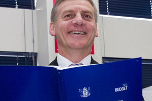 Finance Minister Bill English viewing a copy of the 2013 Budget.  Photo / Mark Mitchell