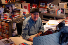 Graham Beattie loves his cluttered library. Photo / NZH