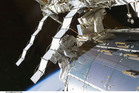 Spacewalking repair halts leak