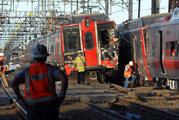 Emergency personnel work at the scene where two Metro North commuter trains collided. Photo / AP