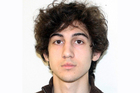 Dzhokhar Tsarnaev wrote a note calling the victims of a Boston bomb attack 'collateral damage', reports say. Photo / AP