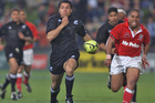All Black debutante Doug Howlett powers away to score his first test try during the 102-0 All Black victory over Tonga at North Harbour Stadium in 2000. Photo / Peter Meecham