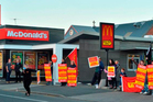 Unite Union members protest in what they called a ''McStrike'' outside the North Dunedin branch of McDonald's yesterday afternoon. Photo / Gerard O'Brien