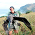 Department of Conservation biodiversity ranger Mel Young releases the petrel on Otago Peninsula. Photo / Linda Robertson