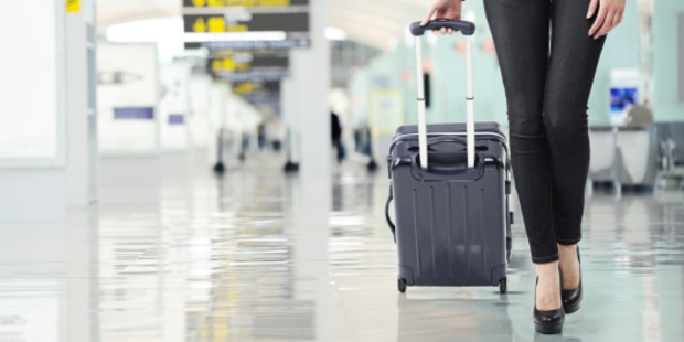 Are female travellers taking up their partners luggage space? Photo / Thinkstock