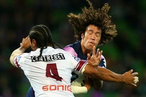 Kevin Proctor is tackled by Manly's Steve Matai during the NRL match between the Storm and Sea Eagles in Melbourne. Photo / Getty Images