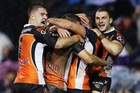 Tiger players celebrate a try in their 22-20 win over the Cowboys. Photo / Getty Images