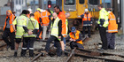 Kiwirail staff inspect debris and damage to the track after a passenger train derailed in Wellington. Photo / Mark Mitchell