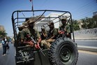 Pakistani soldiers deploy near a voting station ahead of re-polling on National assembly seat NA250 in Karachi.Photo / AFP