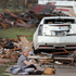 Kay James holds her cat as she sits in her driveway after her home was destroyed by the tornado that hit the area in Oklahoma City, Oklahoma. Photo / AP