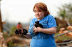 Rachel Hilton holds stray kittens she found in the debris of her parents' home at SW 149th and Stone Meadows Dr. after a tornado struck south Oklahoma City and Moore, Oklahoma. Photo / AP
