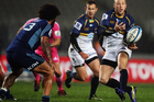 Jesse Mogg of the Brumbies passes the ball out during the round 15 Super Rugby match between the Blues and the Brumbies. Photo / Getty Images.