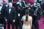"Eva Longoria, Doutzen Kroes and French designer Christian Louboutin walk the red carpet for Iranian Oscar-winner Asghar Farhadi's ""The Past"" at the Cannes Film Festival."