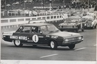 Benson and Hedges 500 Pukekohe, Chrysler Valiant Regal driven by Grady Thomson sliding at Champion corner just after the start. 29 August 1970. Photo / NZ Herald Archive