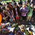 Students gather at a makeshift memorial outside Peter Hobart Elementary School as they arrive for classes. Photo / AP