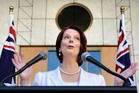 Prime Minister Julia Gillard challenged Opposition Leader Tony Abbott to allow his MPs to have a conscience vote on gay marriage. Photo / AP