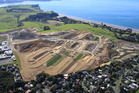 Work has begun on Todd Property's huge estate - the first residents should be able to move into their new Long Bay house by Christmas. Photo / Supplied