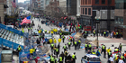 First responders rush to where two explosions occurred along the final stretch of the Boston Marathon on Boylston Street in Boston. Photo / AP