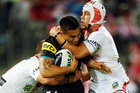 Dean Whare of the Panthers is tackled by Jason Nightingale and Jamie Soward of the Dragons in their NRL clash last night. Photo / Getty Images