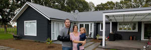 Carlos and Annabel Barbosa with 2-year-old Greta at their Mystery Creek home.  Photo / Christine Cornege