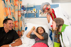 Ava Grace Rongo, 6, meets Steve Price and clown doctors Ian Harcourt and Fingal Pollock. Photo / Mark Tantrum