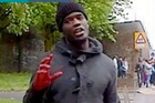 An image taken from video footage made available by ITV shows what appears to be one of the attackers speaking to the camera, holding a knife and a cleaver, after the attack. Photo / AP