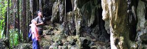 Marshall Humphreys shows tourists through the Anatakitaki Cave on Atiu, part of the Cook Islands. Photo / Jim Eagles